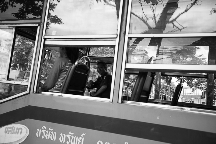 a travel photo of a man on a bus in bangkok thailand
