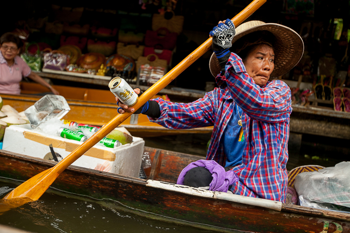 a travel photo of the face of concentration in the floating market in bangkok thailand