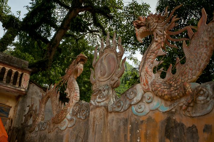 a travel photo of temple door decoration in ha giang vietnam
