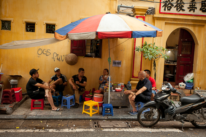 a travel photo of people eating in hanoi vietnam