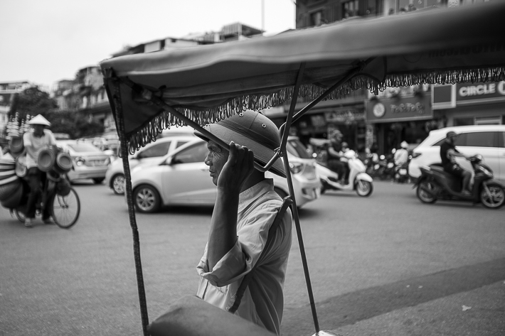 a travel photo of a taxi driver in hanoi vietnam