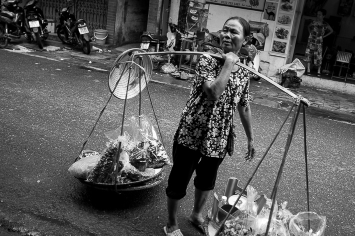 a travel photo of a woman balancing in hanoi vietnam