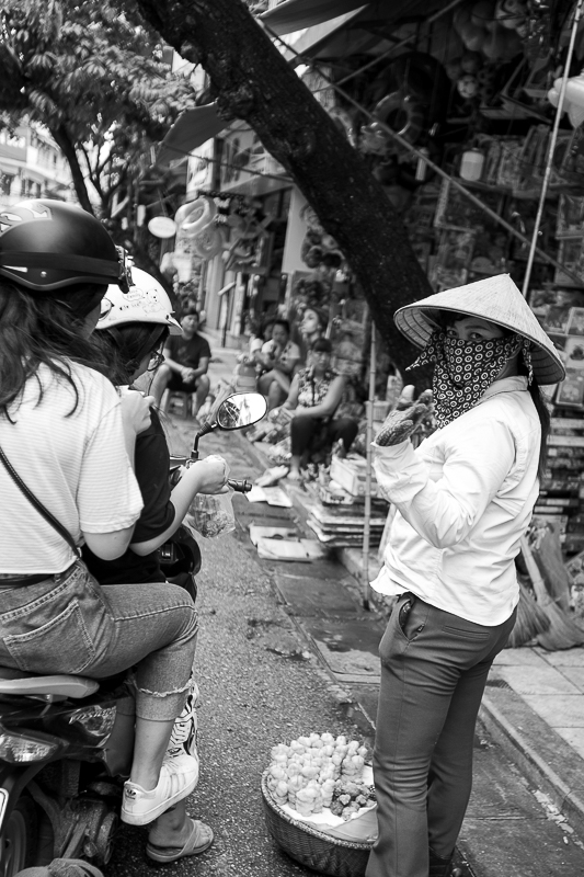 a travel photo of a woman wearing mask in hanoi vietnam