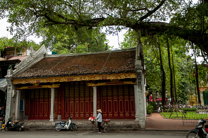 a travel photo of a woman walking in hanoi vietnam