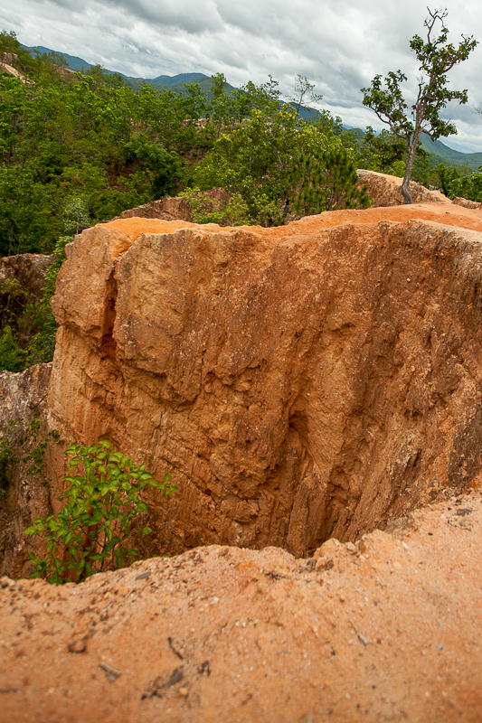 a travel photo of a red canyon in pai thailand