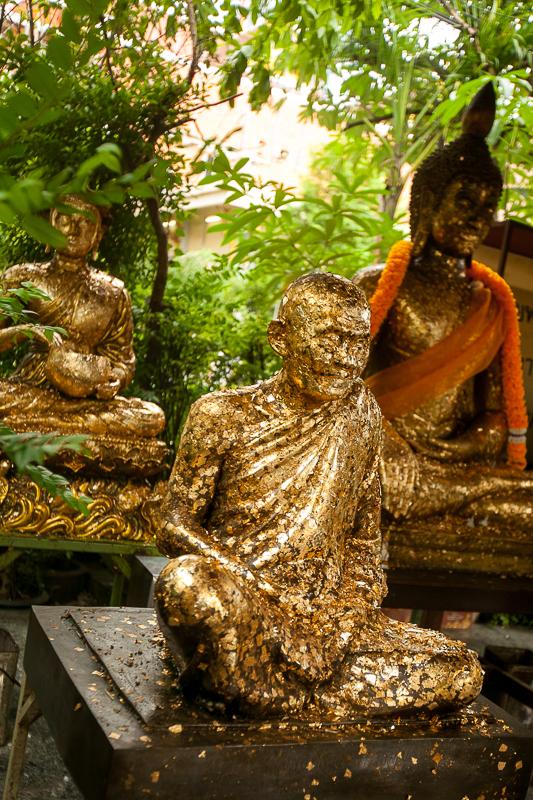 a travel photo of a gold buddha in bangkok thailand