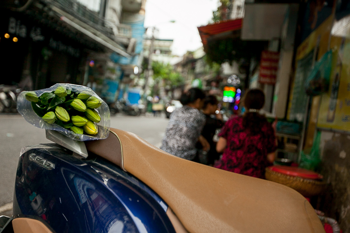 a travel photo of flowers on a motorcycle in hanoi vietnam