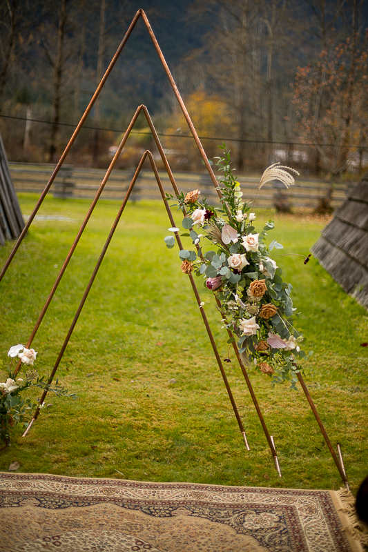 a styled wedding metal arbour with flowers in pemberton british columbia