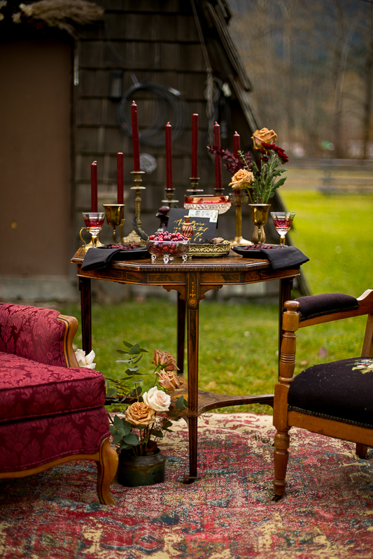 a styled wedding table of burgundy candles and chairs pemberton british columbia