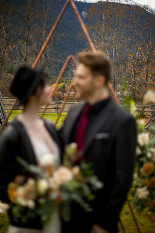 a styled wedding of a couple with a metal arbour in pemberton british columbia