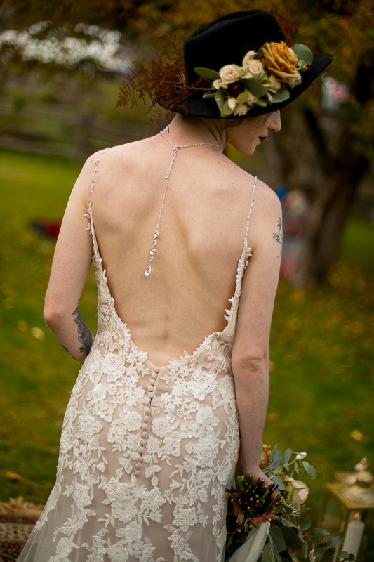 a styled wedding of the back of the dress with a black hat in pemberton british columbia