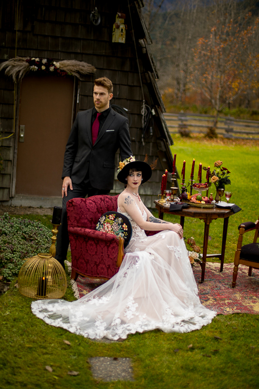 a styled wedding of a couple with burnaby chairs and candles in the autumn pemberton british columbia