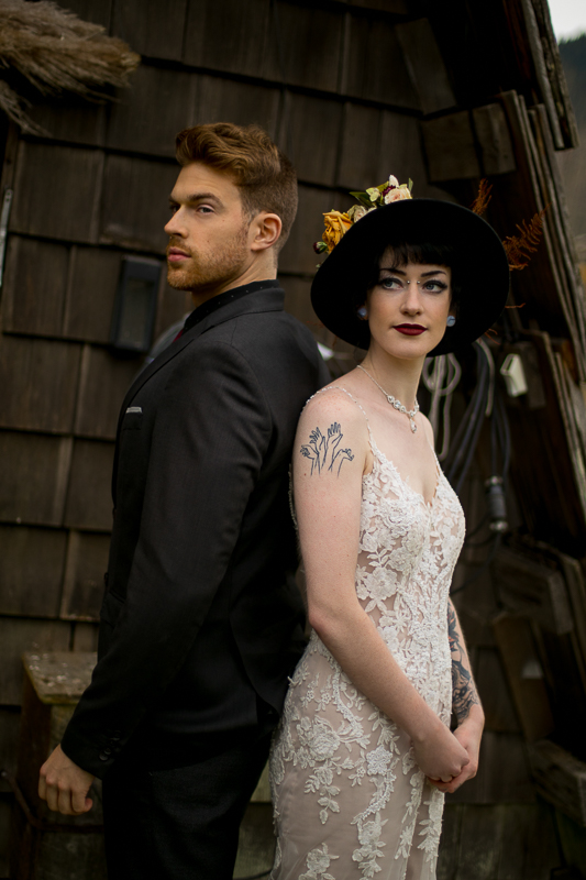 a styled wedding of a couple standing back to back in the autumn pemberton british columbia