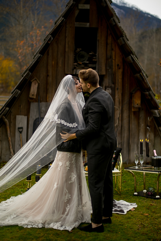 a styled wedding of a couple with the veil being lifted in the autumn pemberton british columbia