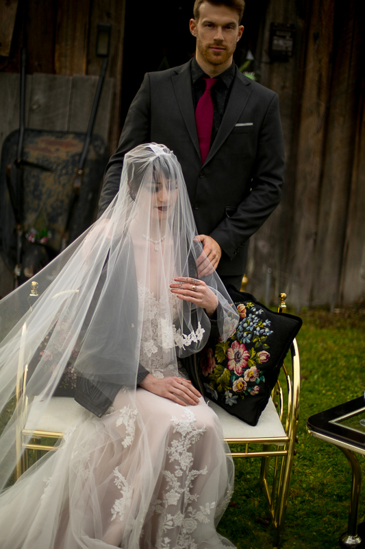 a styled wedding of a couple with the veil over her face in the autumn pemberton british columbia