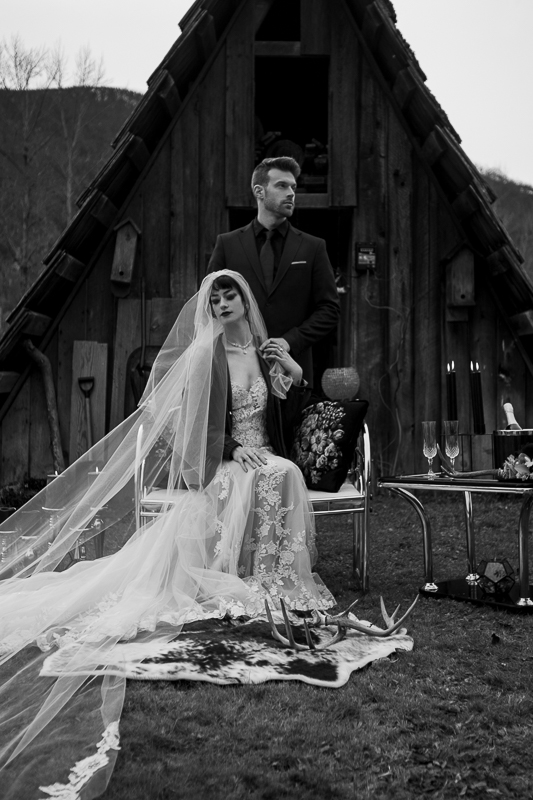 a styled wedding of a couple with the long veil in the autumn pemberton british columbia
