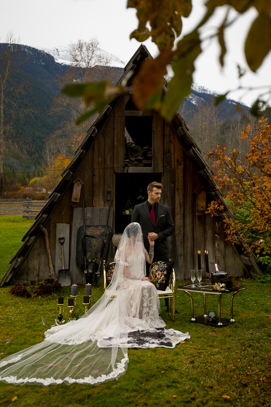a styled wedding of a couple with the long veil and black candles in the autumn pemberton british columbia