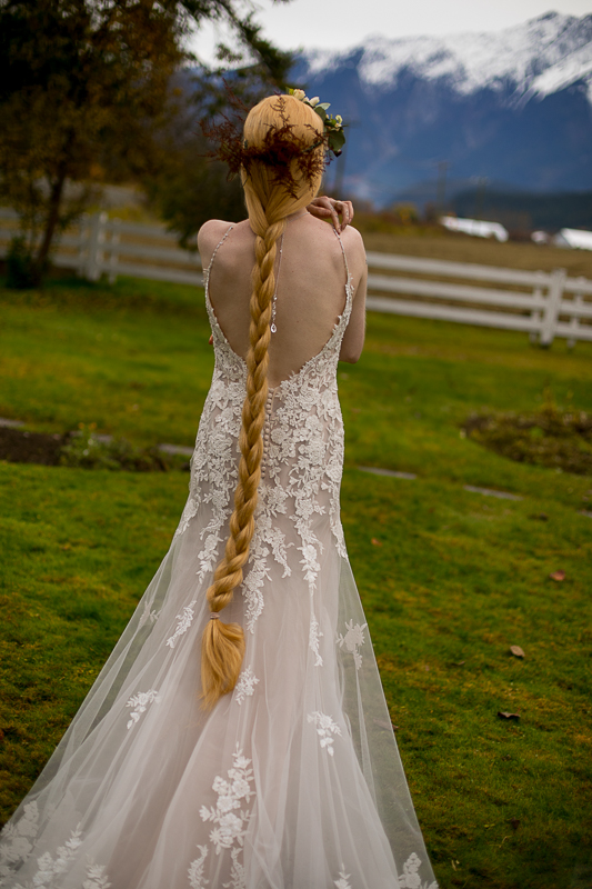 a styled wedding of the back of the dress with a floral crown in pemberton british columbia