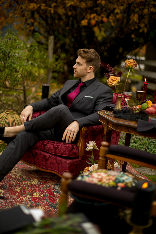a styled wedding of the groom sitting in a burnaby chair in pemberton british columbia