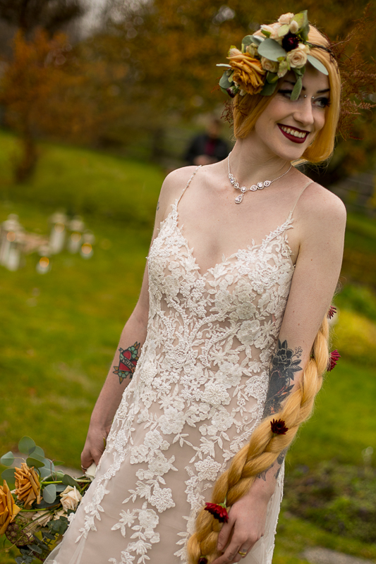 a styled wedding of the bride with tattoos with a floral crown in autumn pemberton british columbia