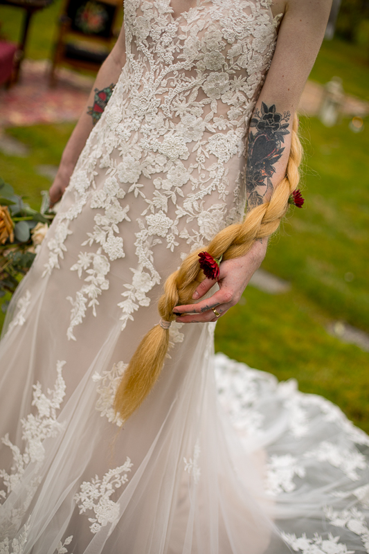 a styled wedding of the brides dress with tattoos in autumn pemberton british columbia