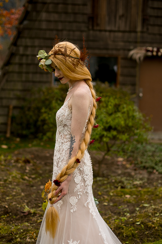 a styled wedding of the bride with a long braid with roses in autumn pemberton british columbia