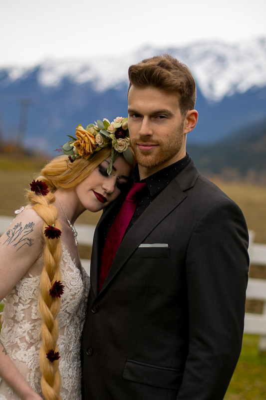 a styled wedding of the couple cuddling in autumn pemberton british columbia