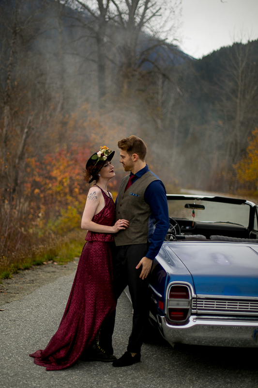 a styled wedding of the couple in a burnaby sequinned dress beside a vintage car in autumn pemberton british columbia