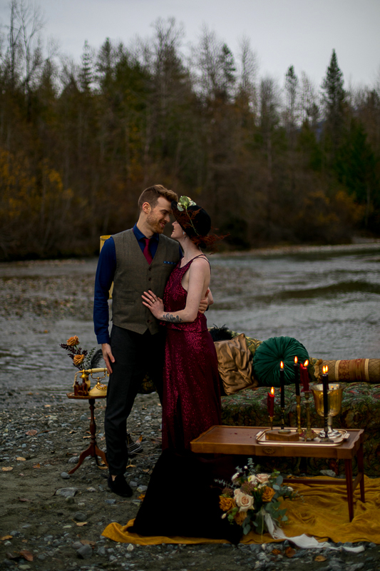 a styled wedding of the couple cuddling on the rocky beach in autumn pemberton british columbia