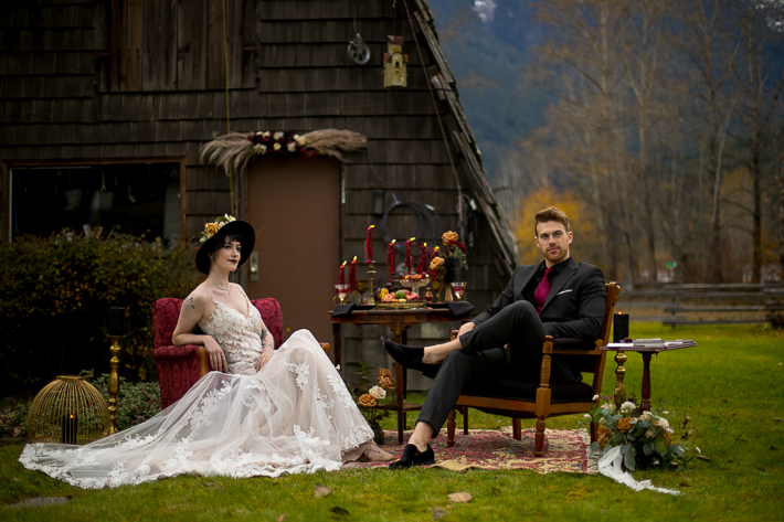 a styled wedding of a couple sitting in burnaby chairs and candles in the autumn pemberton british columbia