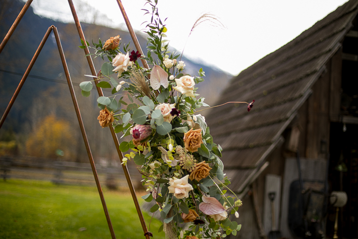 a styled wedding metal arbour with flowers and mountains in pemberton british columbia