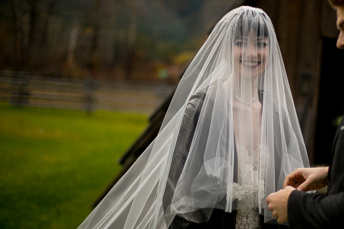 a styled wedding of a with the bride with a veil over her face in the autumn pemberton british columbia