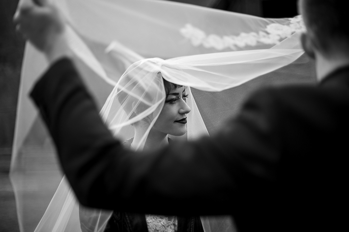 a styled wedding of a with the bride with a veil lifted over her face in the autumn pemberton british columbia