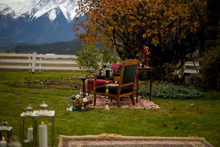 a styled wedding with the burnaby chair decor and a moroccan carpet and mountains in autumn pemberton british columbia
