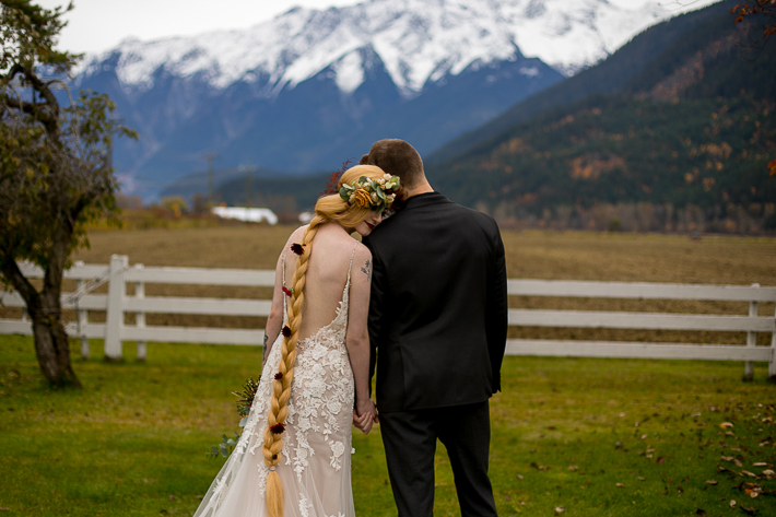 a styled wedding of the bride resting on the grooms shoulder in autumn pemberton british columbia