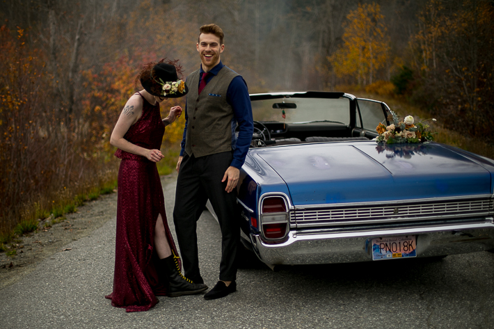 a styled wedding of the couple dancing in a burnaby sequinned dress beside a vintage car in autumn pemberton british columbia