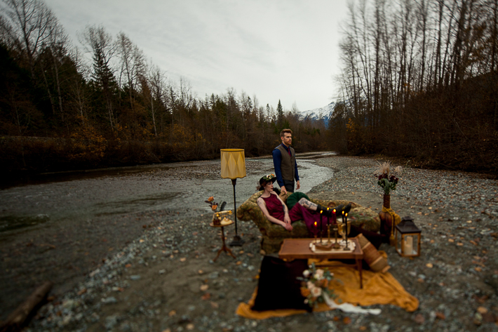 a styled wedding of a couple sitting on the rocky beach in autumn pemberton british columbia