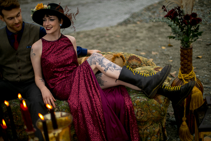 a styled wedding of the bride with a burnaby sequinned dress and black boots and tattoos on the rocky beach in autumn pemberton british columbia