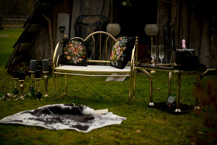 a styled wedding of the setup with black candles a bar and a cow hide pemberton british columbia