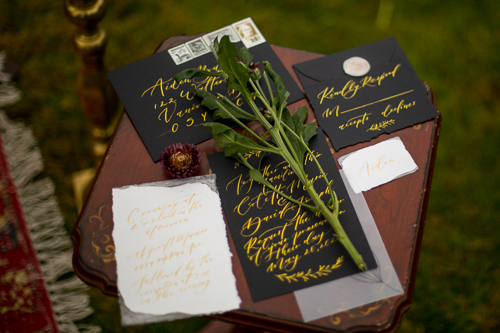 a styled wedding of the table with the invitations and floral decor in the autumn pemberton british columbia