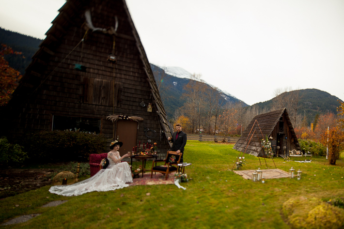 a styled wedding of a couple with burnaby chairs in the autumn pemberton british columbia