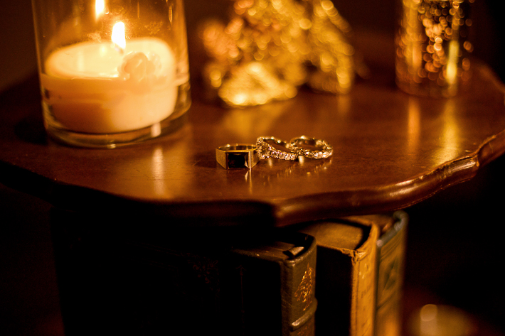 a fall wedding of the reception details rings in front of candles at the westwood plateau golf club coquitlam british columbia