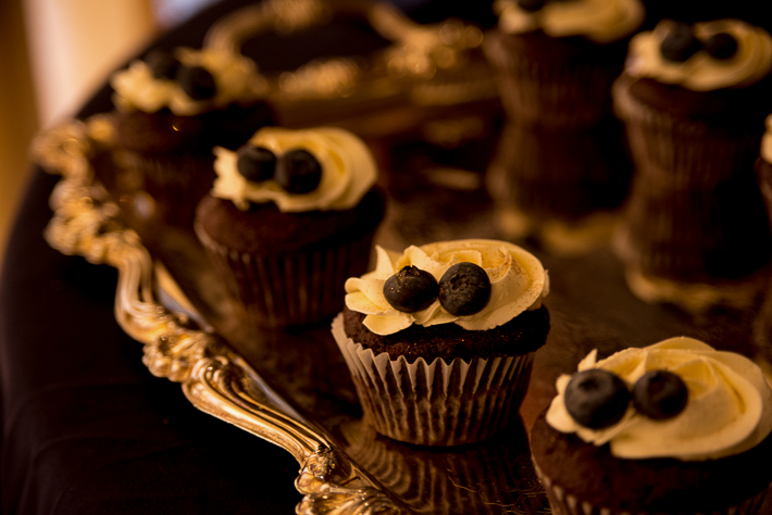a fall wedding of the reception details of the cupcakes with blueberries at the westwood plateau golf club coquitlam british columbia