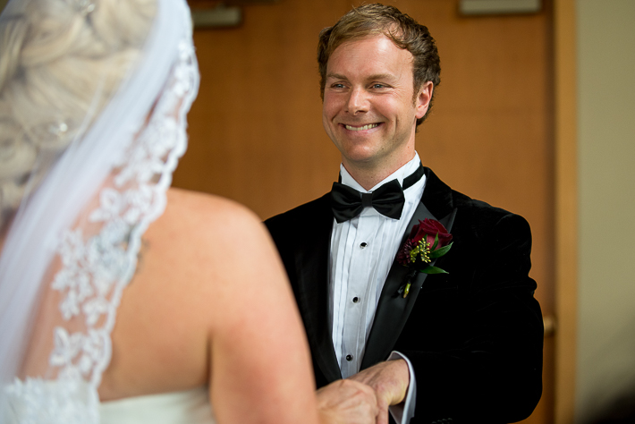 a fall wedding of the ceremony of the happy groom at the westwood plateau golf club coquitlam british columbia