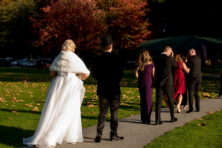 a fall wedding of the wedding party walking at dusk at the westwood plateau golf club coquitlam british columbia