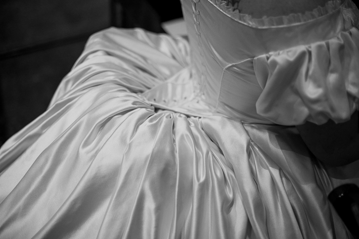 a fall wedding of the back of the brides victorian corset dress at the westwood plateau golf club coquitlam british columbia