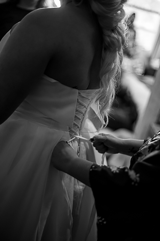 a fall wedding of the bride putting her dress on at the westwood plateau golf club coquitlam british columbia