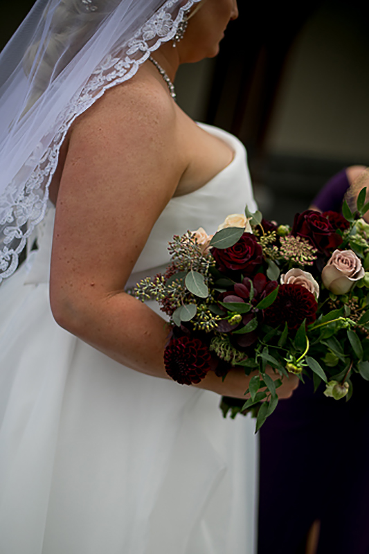 a fall wedding of the brides dress and bouquet at westwood plateau golf club coquitlam british columbia