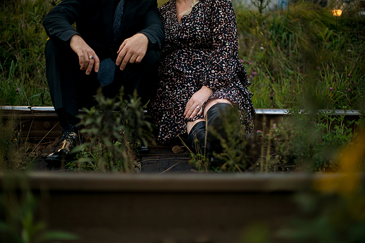 a fall engagement photo the hands of a couple on a railway track in new westminster british columbia