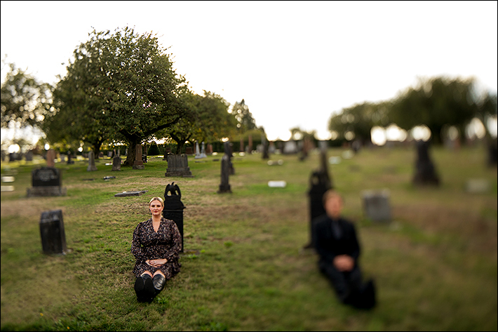 a fall engagement photo of a couple in a cemetery in new westminster british columbia